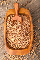 Soybean on a rustic wooden table in a bowl and with a spoon