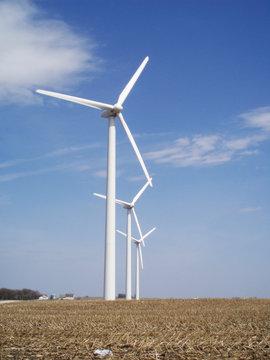 Windmills creating renewable energy on a farm in Iowa, USA