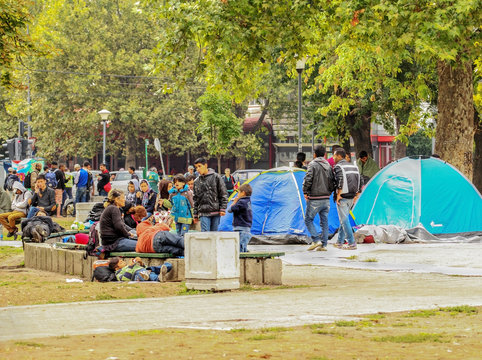 Serbia; Belgrade; August 23, 2015: Syrian Refugees and Migrants Waiting  at beautiful ambiance Park in Belgrade, Serbia.