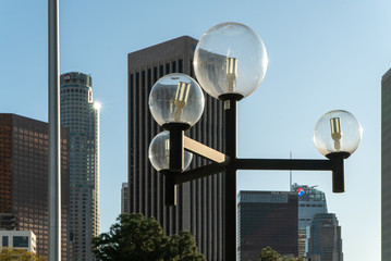 LOS ANGELES, CA, MAR 2020: LED street lights in glass spheres with Downtown skyline in background