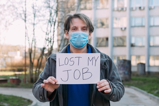 Job loss due to COVID-19 virus pandemic concept. man holds sign lost my job