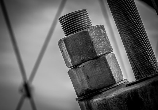 Pair of giant nuts on bridge cable supports on a bridge in Southern Oregon - black and white