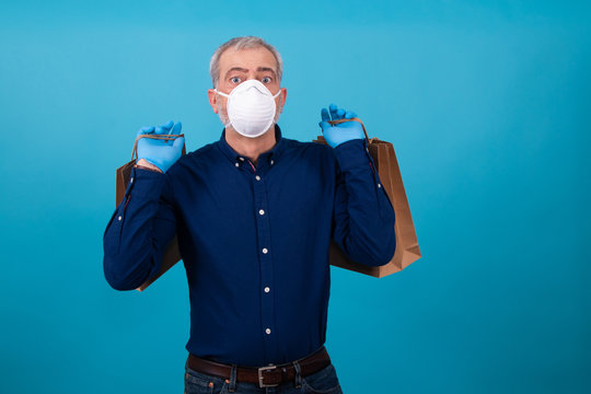 isolated man with shopping bags mask and gloves
