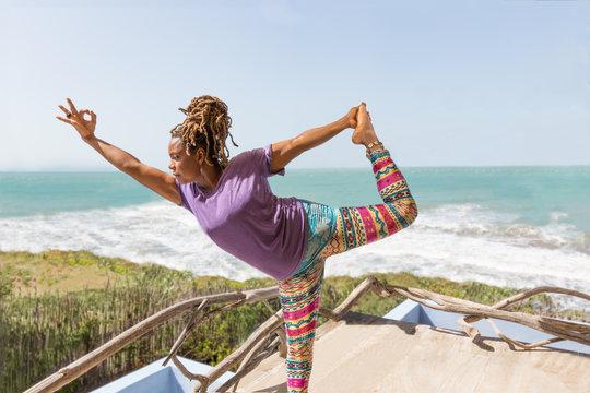 Beautiful Black Woman Doing Yoga on Tropical Beach