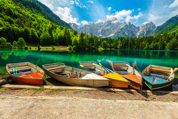 Wall Mural - Colorful tourist boats anchored on the lake Fusine, Italy