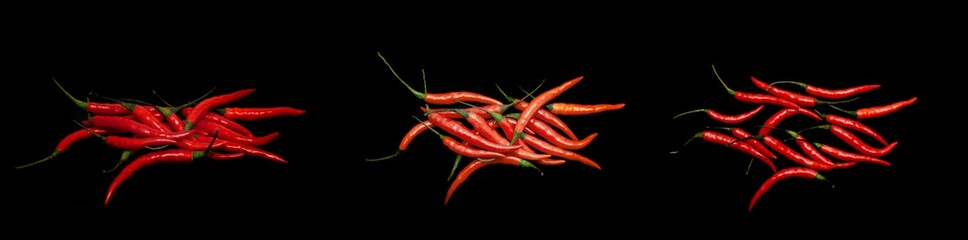 Foto auf AluDibond Hot Chili Peppers Red chili pepper isolated on a black background.