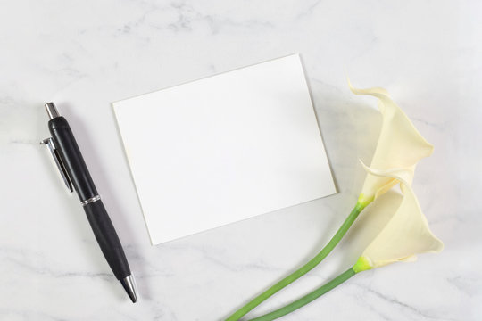 Invitation Mockup with Calla Lilies and a Pen