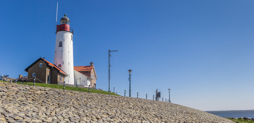 Fototapete - Panorama of the historic white lighthouse on top of the dike in Urk, Netherlands