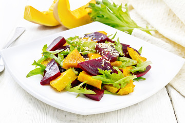 Wall Mural - Salad of pumpkin and beetroot in plate on light board