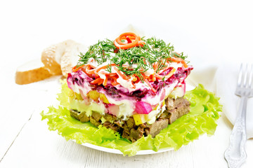 Wall Mural - Salad with beef and vegetables on white board
