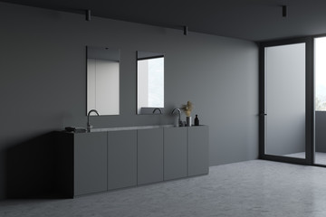 Double sink in minimalistic gray bathroom corner