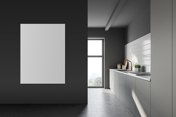 Dark grey kitchen with countertops and poster