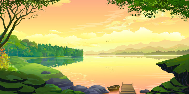 A sunset view of a lake with mountains and the orange skies.