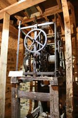 Dinan, France. Clock mechanism in a clock tower