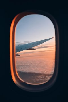 Beautiful sunset look through airplane window