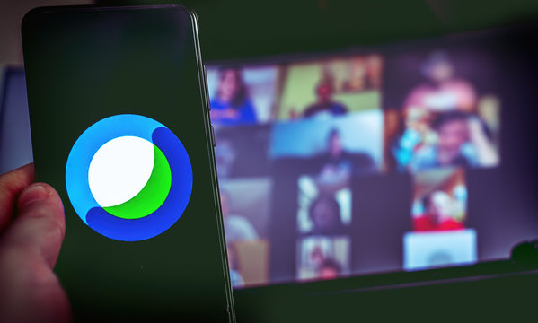 hand use videoconference app icon of Cisco Webex on smartphone