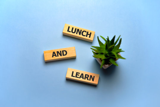 the text on wooden blocks : Lunch and Learn.