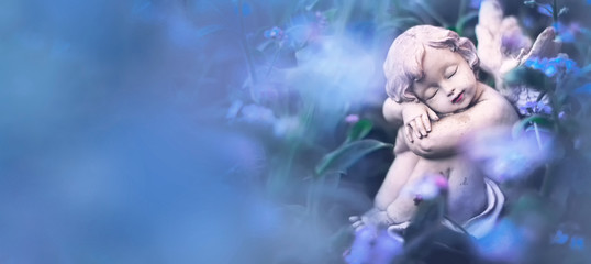Guardian angel sleeping in flowers