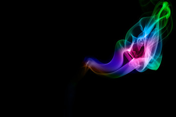 Abstract colored smoke on black background