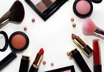 Beautiful decorative cosmetics powder in balls, bright lipstick, blush, eyeshadow and cosmetic...