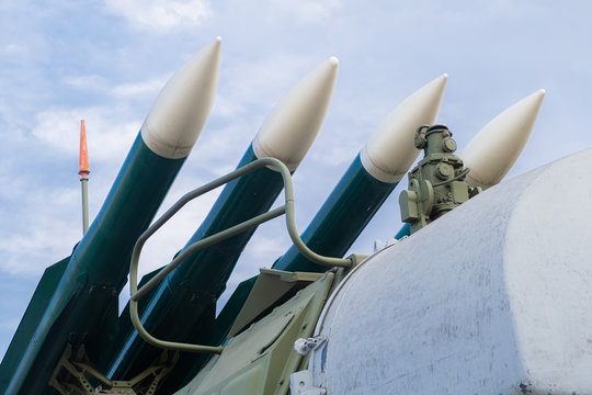 Missiles ready to launch, weapons of mass destruction, preparation for war and fight against terrorism against the blue of the peaceful sky