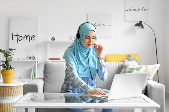 Muslim technical support agent working at home