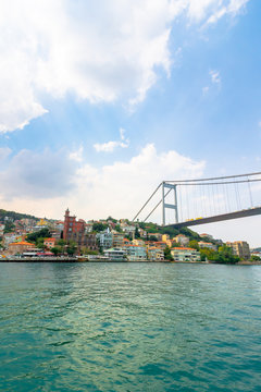 istanbul, turkey - AUG 18, 2015: fatih sultan mehmet bridge above the bosphorus. beautiful cityscape of historical area observed from the water on a sunny summer day. calm weather with fluffy clouds