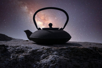 teapot for brewing tea on background a starry sky