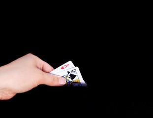hand holding blackjack cards