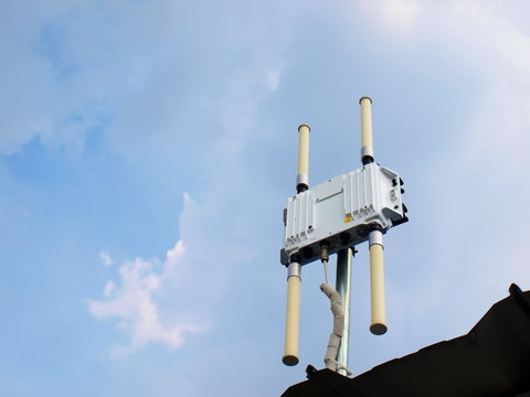 WiFi HotSpot Outdoor, wifi extender, Wireless Router Wi-Fi Access Point long range on the roof of the office. On the blue sky background with white clouds