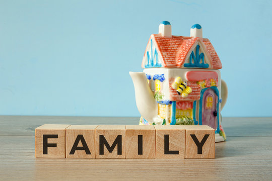 Family - word on wooden cubes, concept family