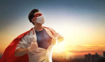 Doctor wearing facemask and superhero cape