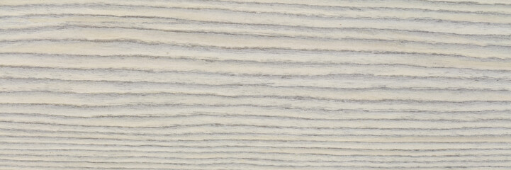 Beautiful light grey ebony veneer background. Natural wood texture, pattern of a long veneer sheet, plank.
