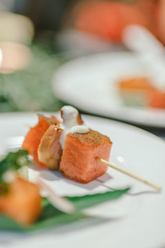 Close-up Of Roasted Duck In Skewer Served On Plate