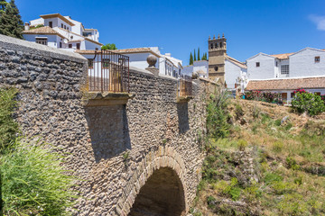 Fototapete - Puente Viejo bridge and church tower in Ronda, Spain