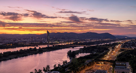 Vienna at sunset with the Danube River and the extensive public recreation area called Danube Island