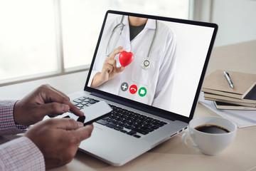 online consultation telemedicine to medicine  man stayhome video call with her doctor healthcare...