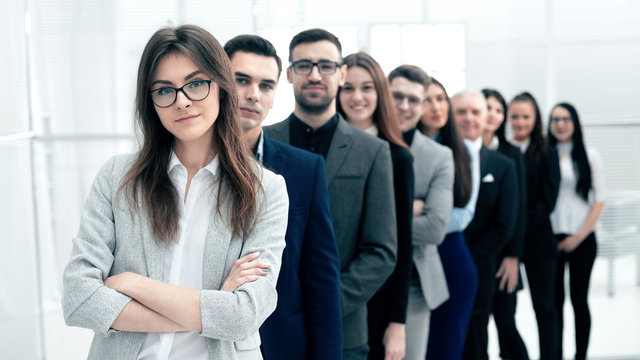 large group of young business people standing in a row.