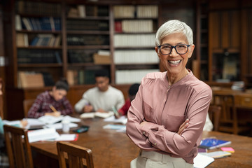 Smiling university professor in library