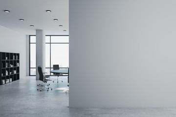 Luxury meeting room with blank gray wall.