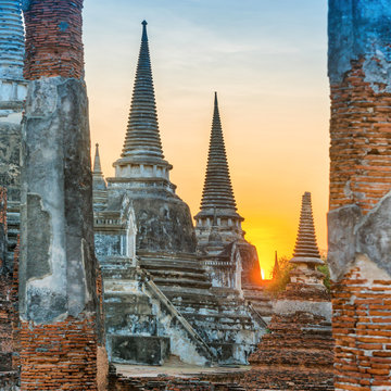 Brick ruins and three white stupas of ancient buddhist temple Wat Phra Si Sanphet. Historical architecture of Ayutthaya, Thailand