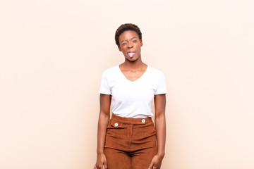 young pretty black womanlooking goofy and funny with a silly cross-eyed expression, joking and fooling around