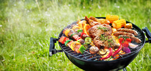 Assorted delicious grilled meat with vegetables on barbecue grill