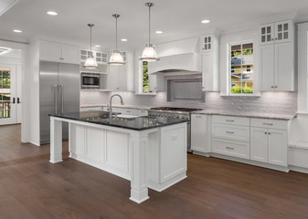 Kitchen in new luxury home with hardwood floor and stainless steel appliances