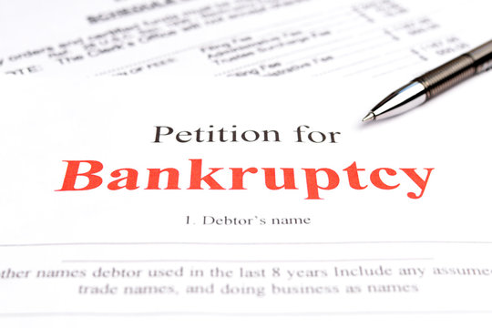 Bankruptcy concept. Close-up bankruptcy petition and pen.