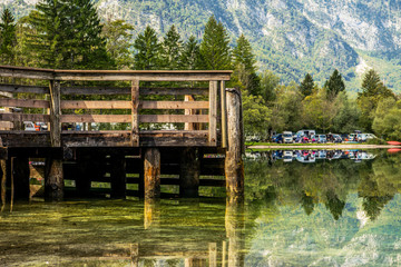 Wall Mural - Panoramic View Of Mountains Lake And Wooden Pier In Slovenia.