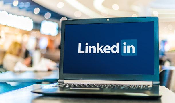 Laptop computer displaying logo of LinkedIn