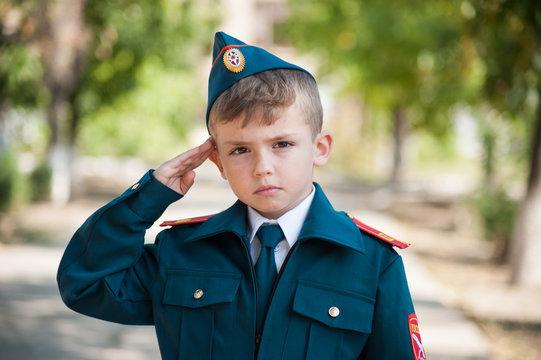 cadet boy in uniform on the street. Study at school