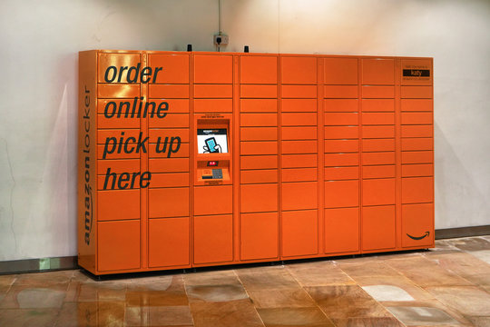 London, United Kingdom - February 01, 2019: Orange Amazon locker in lower floor at One New Change shopping centre. Service is used for pick up of orders delivered from on-line store