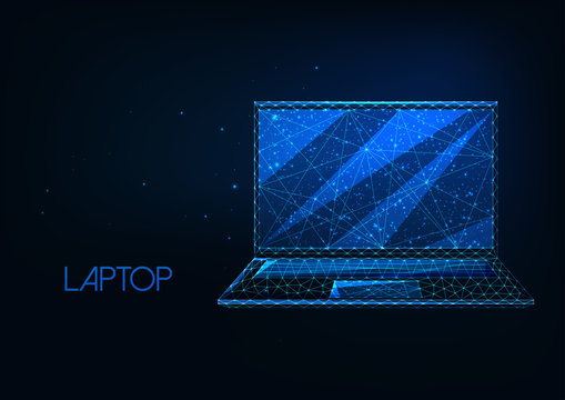 Futuristic glowing low polygonal laptop isolated on dark blue background.